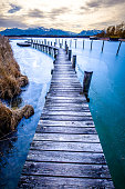 jetty at the famous chiemsee lake in bavaria - germany