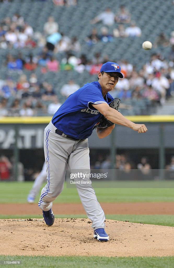 Chien-Ming Wang #67 of the Toronto Blue Jays pitches against the Chicago White Sox during the first inning on June 11, 2013 at U.S. Cellular Field in Chicago, Illinois.