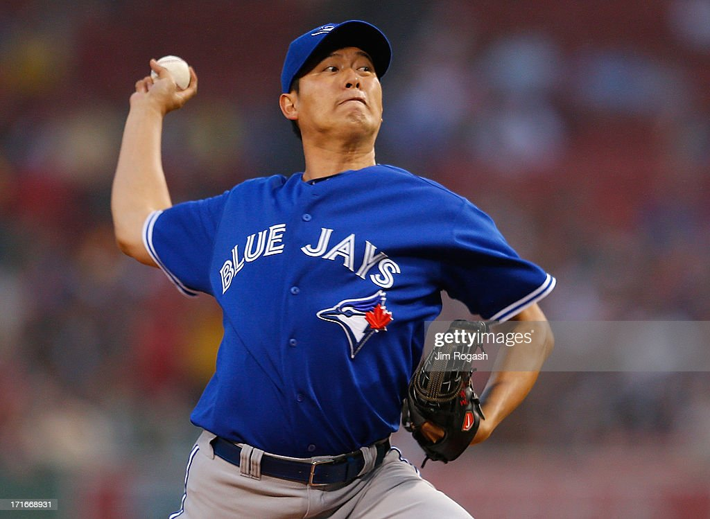 Chien-Ming Wang #67 of the Toronto Blue Jays throw in the 1st against Boston Red Sox at Fenway Park on June 27, 2013 in Boston, Massachusetts.