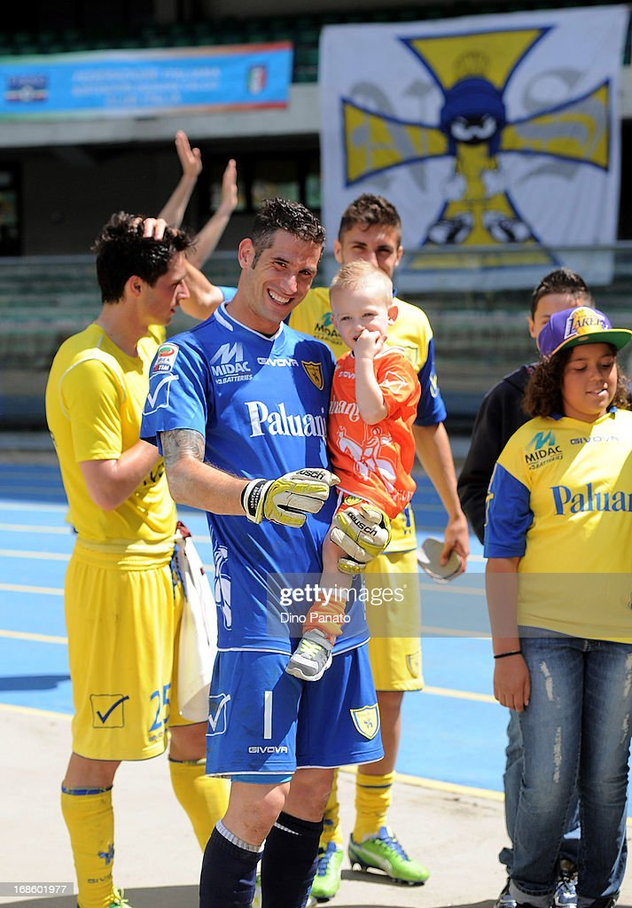 AC Chievo goalkeeper Christian Puggioni celebrates with his child after the Serie A match between AC Chievo Verona and Torino FC at Stadio Marc'Antonio Bentegodi on May 12, 2013 in Verona, Italy.