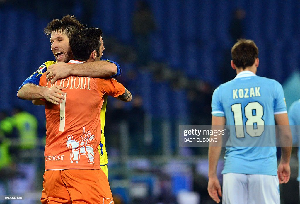 Chievo goalkeeper Christian Puggioni (L) celebrates with his teammate Bostjan Cesar after the Italian Serie A football match between Lazio Rome and Chievo Verona on January 26, 2013, at the Olympic stadium in Rome. Chievo won 1-0.