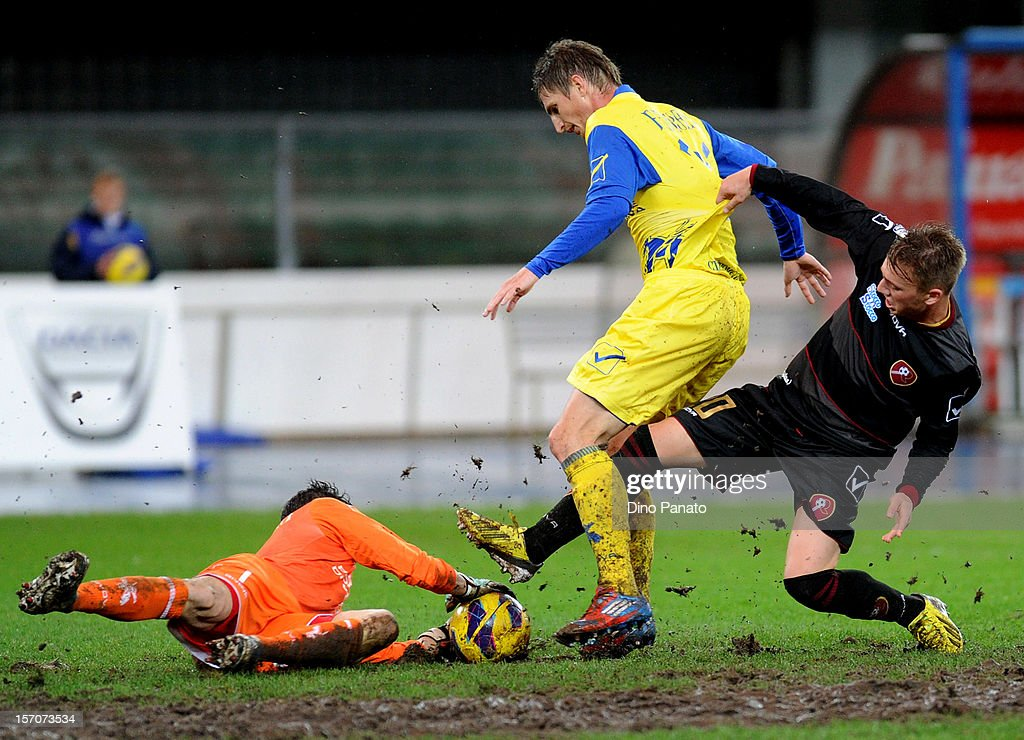 Chievo goalkeeper Christian Puggioni makes a save at the feet of Manuel Fishnaller of Reggina during the TIM Cup match between AC Chievo Verona and...