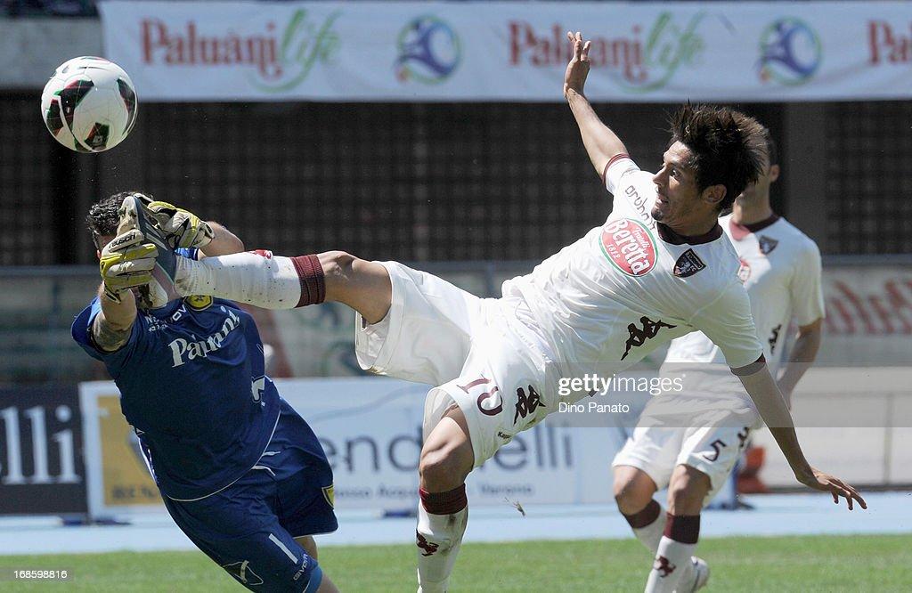 AC Chievo goalkeeper Christian Puggioni (L) makes a save at the feet of Vitor Barreto of Torino FC during the Serie A match between AC Chievo Verona and Torino FC at Stadio Marc'Antonio Bentegodi on May 12, 2013 in Verona, Italy.