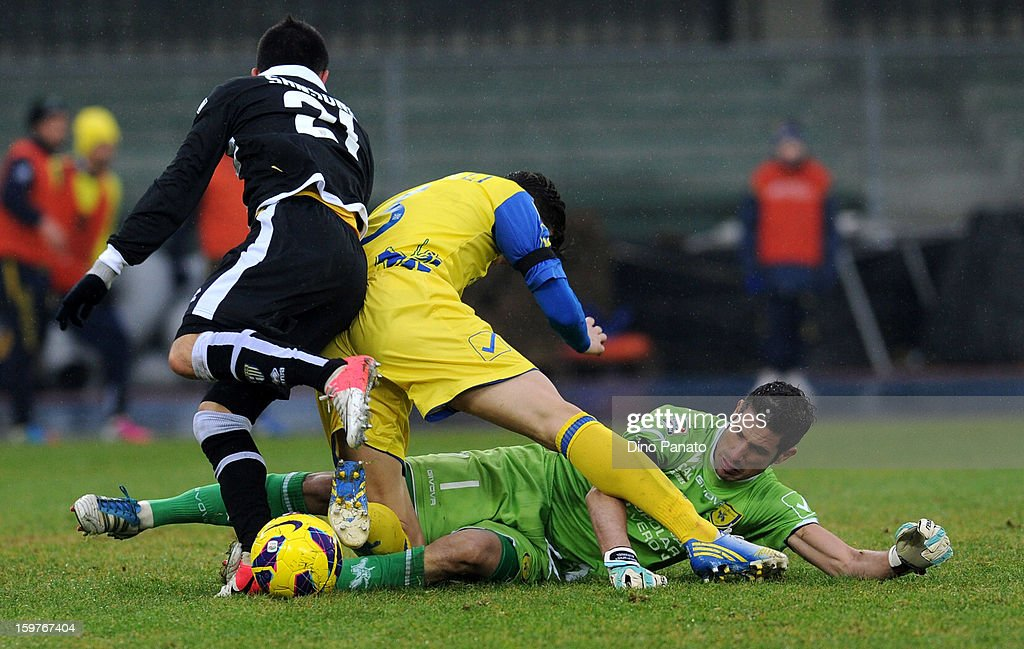 AC Chievo Verona goalkeeper Christian Puggioni (R) makes a save at the feet of Nicola Sansone of Parma FC during the Serie A match between AC Chievo Verona and Parma FC at Stadio Marc'Antonio Bentegodi on January 20, 2013 in Verona, Italy.