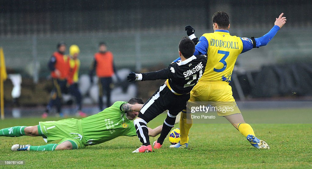 AC Chievo Verona goalkeeper Christian Puggioni (L) makes a save at the feet of Nicola Sansone of Parma FC during the Serie A match between AC Chievo Verona and Parma FC at Stadio Marc'Antonio Bentegodi on January 20, 2013 in Verona, Italy.
