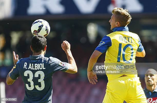 Chievo's Argentinian forward Maxi Lopez fights for the ball with Napoli's Spanish defender Raul Albiol during the Italian Serie A football match SSC...