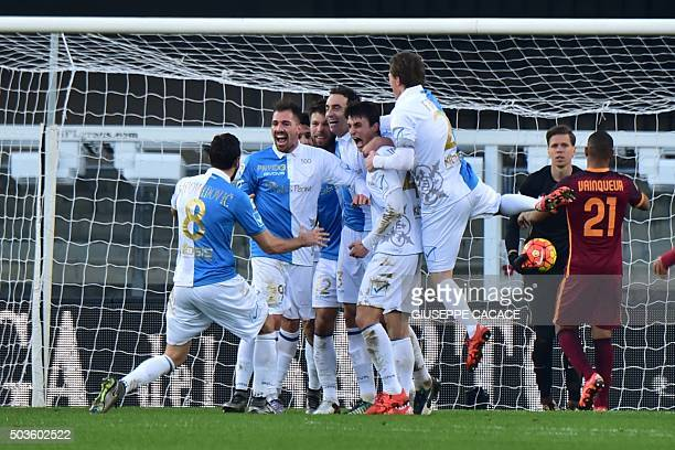 Chievo's defender from Italy Dario Dainelli celebrates with teammates after scoring during the Italian Serie A football match between Chievo Verona...