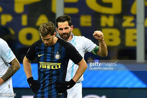 Chievo's forward from Italy Sergio Pellissier celebrates after scoring a goal behind Inter Milan's defender from Argentina Cristian Ansaldi during...
