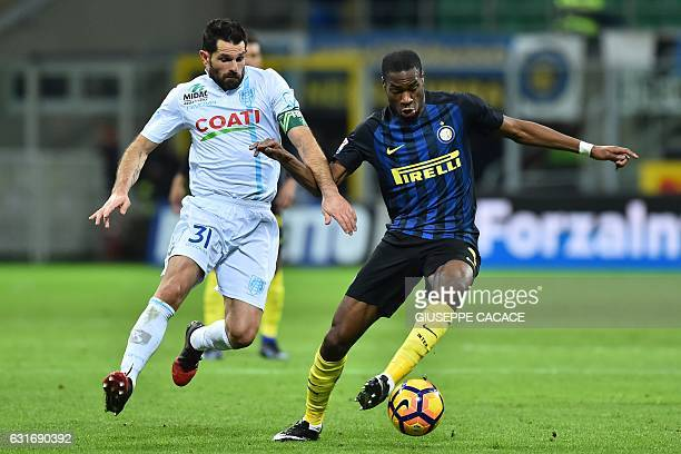Chievo's forward from Italy Sergio Pellissier fights for the ball with Inter Milan's midfielder from France Geoffrey Kondogbia during the Italian...