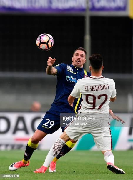 Chievo's Italian defender Fabrizio Cacciatore vies with AS Roma's Italian forward Stephan El Shaarawy during the Italian Serie A football match...