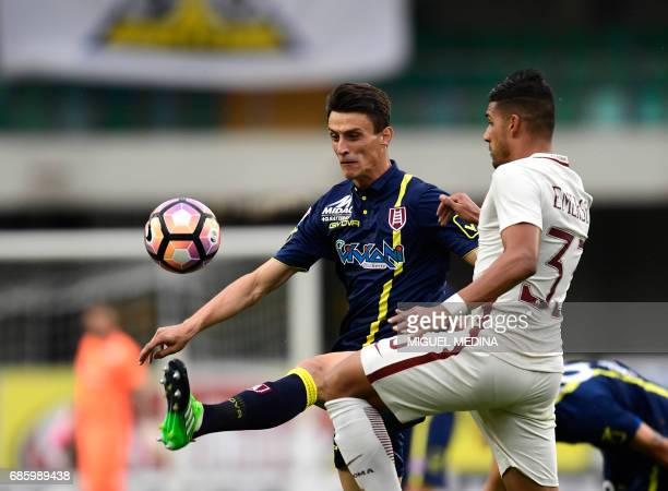 Chievo's Italian forward Roberto Inglese vies with AS Roma's Brazilian defender Emerson during the Italian Serie A football match Chievo vs AS Roma...
