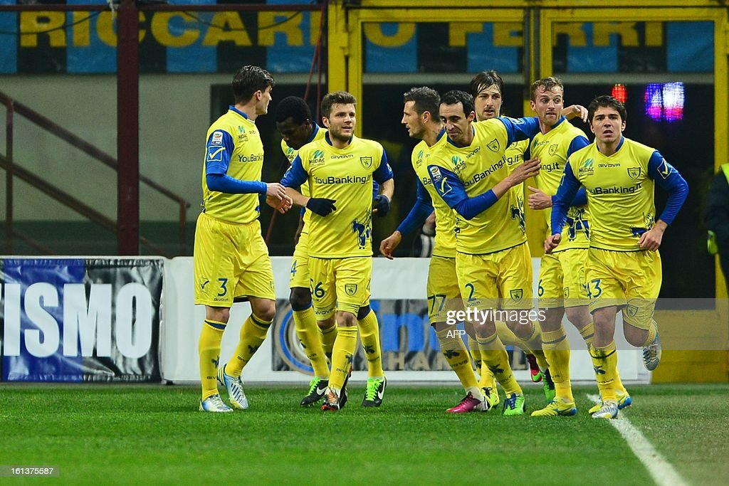 Chievo's midfielder Marco Rigoni (C) celebrates with team mates after scoring a goal during an Italian Serie A football match between Inter Milan and Chievo at San Siro Stadium in Milan on February 10, 2013. AFP PHOTO / GIUSEPPE CACACE