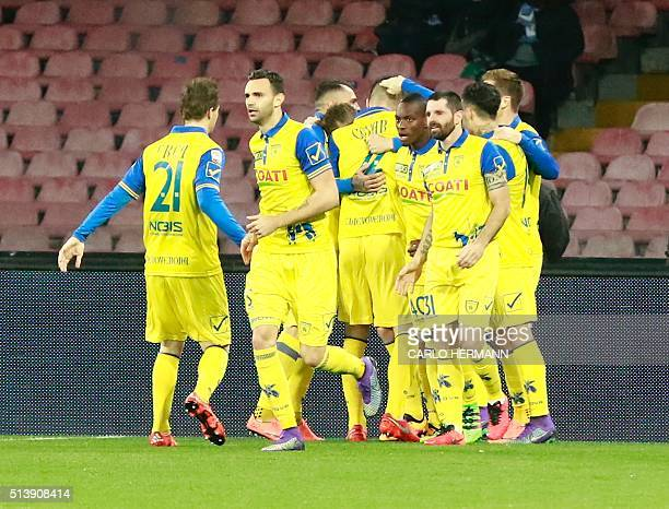 Chievo's players celebrate after scoring a goal during the Italian Serie A football match SSC Napoli vs AC Chievo Verona on March 5 2016 at the San...