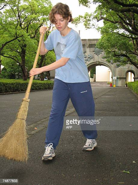 TO GO WITH FRENCH STORY 'JAPONFRANCEEDUCATIONPOLITIQUE' French trainee Marion Cossin sweeps thre pavement at the campus of Matsushita Institute of...
