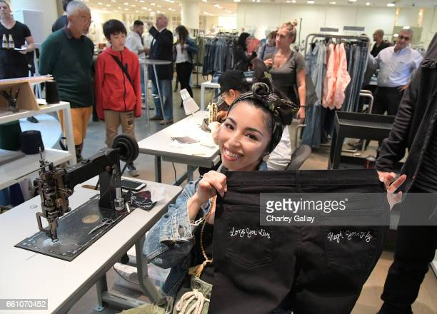 Chiharu Jutargate of The Chain Gang team customizing pieces at Barneys New York x Chain Gang Residency at Barneys New York Beverly Hills on March 30...