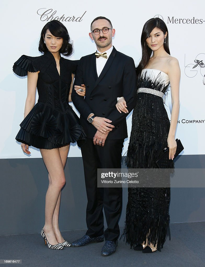 Chiharu Okunugi, Ullrich Moller Jorgensen and Sui He attend attend amfAR's 20th Annual Cinema Against AIDS during The 66th Annual Cannes Film Festival at Hotel du Cap-Eden-Roc on May 23, 2013 in Cap d'Antibes, France.