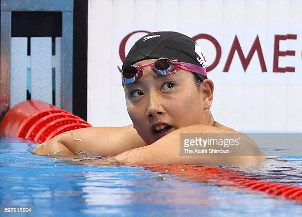 Chihiro Igarashi of Japan reacts after competing in the Women's 200m Freestyle heat on Day 3 of the Rio 2016 Olympic Games at the Olympic Aquatics...