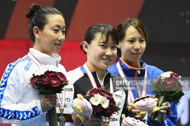Chihiro Igarashi Sayuki Ouchi and Aya Satou of Japan pose with their medals on the podium after the 50m Freestyle Final during the Japan Open 2017 at...