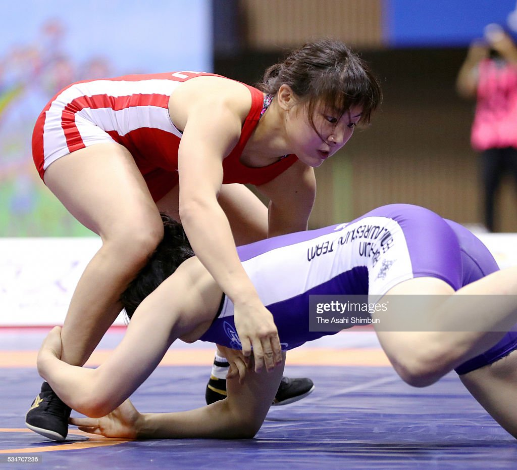 Chiho Hamada (red) and Yuzuru Kumano (blue) compete in the Women's -58kg final during day one of the All Japan Wrestling Invitational Championships at the Yoyogi National Gymnasium on May 27, 2016 in Tokyo, Japan.