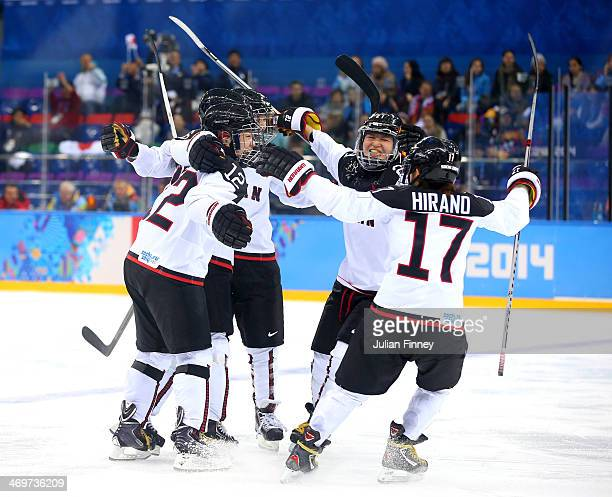 Chiho Osawa Hanae Kubo Yuka Hirano and Sena Suzuki of Japan celebrate a goal in the second period against Russia during the Women's Ice Hockey...