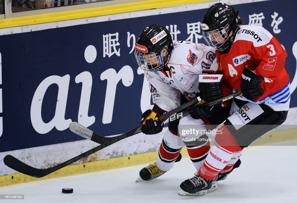 Chiho Osawa (L) of Japan and Anja Stiefel (R) of Switzerland in action in the match between Japan and Switzerland during day three of the Ice Hockey Women's 5 Nations Tournament at the Shin Yokohama Skate Center on November 9, 2013 in Yokohama, Japan.