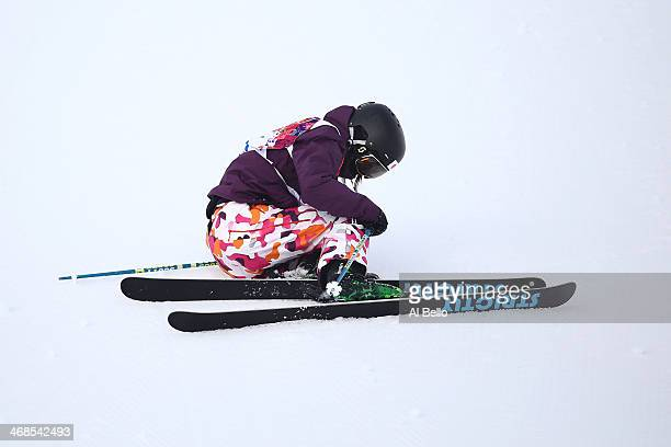 Chiho Takao of Japan falls in the Freestyle Skiing Women's Ski Slopestyle Qualification on day four of the Sochi 2014 Winter Olympics at Rosa Khutor...