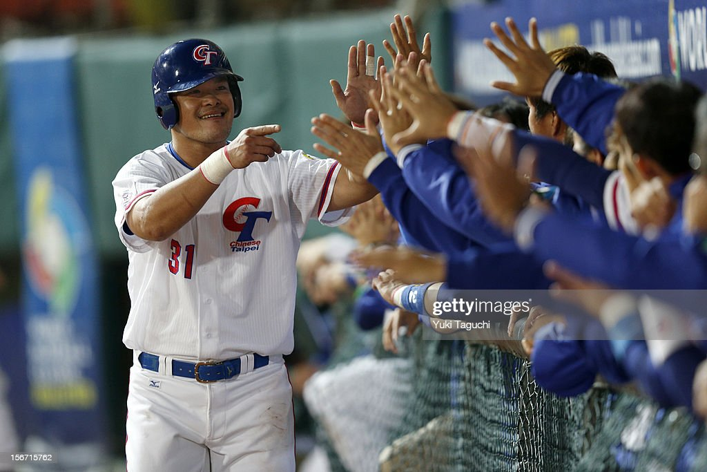 Chih-Shen Lin #31 of Team Chinese Taipei is greeted in the dugout after scoring a run in the bottom of the fourth inning during Game 6 of the 2013 World Baseball Classic Qualifier against Team New Zealand at Xinzhuang Stadium in New Taipei City, Taiwan on Sunday, November 18, 2012.