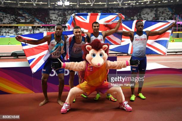 Chijindu Ujah Adam Gemili Daniel Talbot and Nethaneel MitchellBlake of Great Britain celebrate with Hero the Hedgehog winning gold in the Men's 4x100...