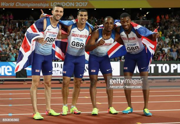 Chijindu Ujah Adam Gemili Daniel Talbot and Nethaneel MitchellBlake of Great Britain celebrate winning gold in the Men's 4x100 Relay final during day...