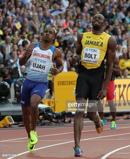Chijindu Ujah of Great Britain and Northern Ireland and Usain Bolt of Jamaica competing in the semifinal of the men's 100 metres during day two of...