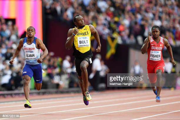 Chijindu Ujah of Great Britain and Usain Bolt of Jamaica and Andrew Fisher of Bahrain competes in the Men's 100 metres semifinals during day two of...