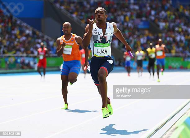 Chijindu Ujah of Great Britain competes in round one of the Men's 4 x 100m Relay on Day 13 of the Rio 2016 Olympic Games at the Olympic Stadium on...