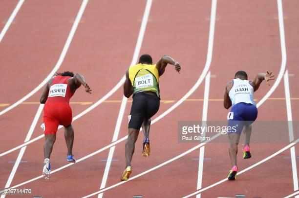 Chijindu Ujah of Great Britain Usain Bolt of Jamaica Andrew Fisher of Bahrain compete in the Men's 100 metres semifinals during day two of the 16th...