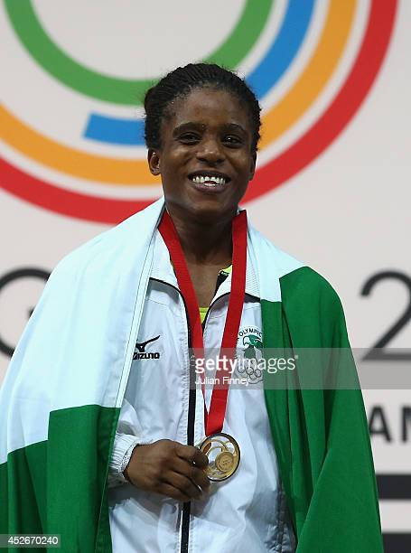 Chika Amalaha of Nigeria with her gold medal after winning the Women's 53kg Group A Weightlifting at the Scottish Exhibition And Conference Centre...