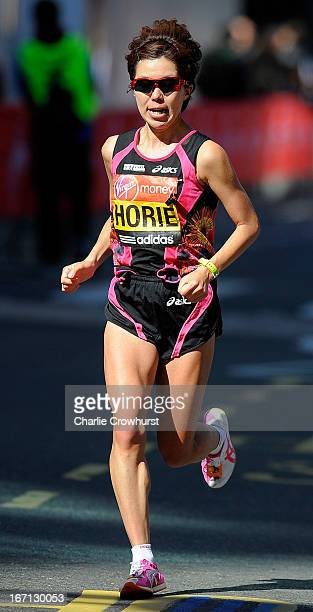 Chika Horie of Japan runs through Canary Wharf during the Virgin London Marathon 2013 on April 21 2013 in London England