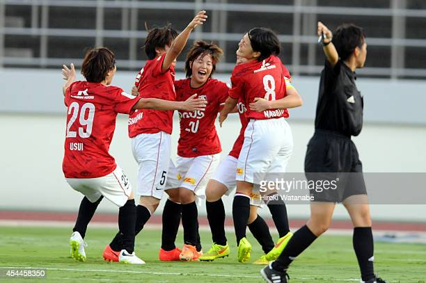 Chika Kato of Urawa Reds Ladies celebrates scoring her team's first goal with her teammates during the Nadeshiko League Exciting Series match between...