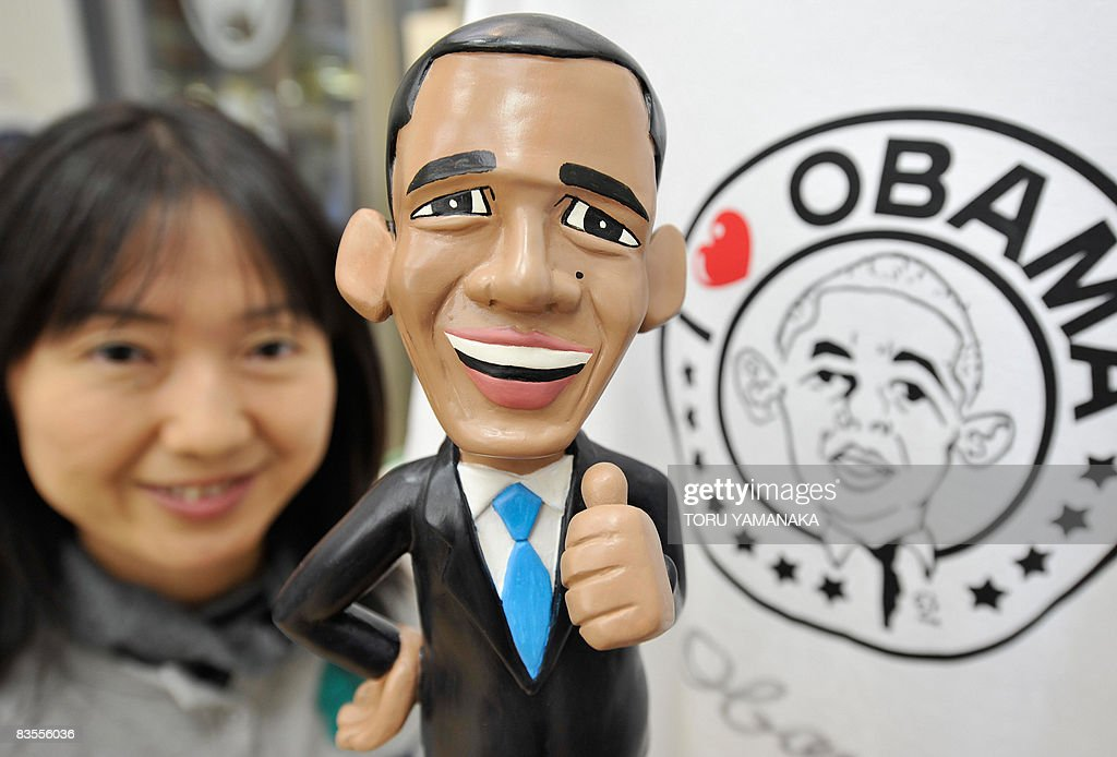 Chika Shimada a clerk for a souvenir shop holds a doll featuring US Democratic presidential candidate Senator Barack Obama in front of 'I Love...