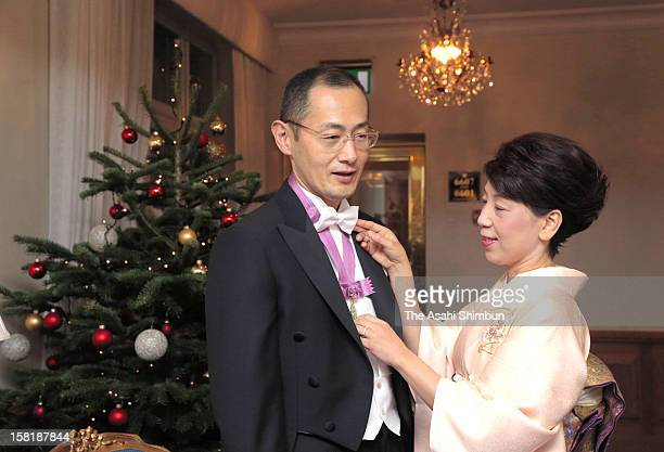 Chika Yamanaka wife of Nobel Prize in Medicine laureate Shinya Yamanaka arranges her hudsband's bow tie ahead of the Nobel Prize Award Ceremony on...