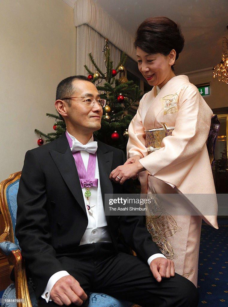 Chika Yamanaka wife of Nobel Prize in Medicine laureate Shinya Yamanaka arranges her hudsband's bow tie ahead of the Nobel Prize Award Ceremony on...