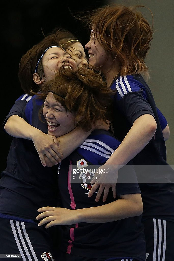 Chikage Kichibayashi #7 of Japan is congratulated by team mates after scoring a goal against Iran during the Women's Futsal Gold Medal match at Songdo Global University Campus Gymnasium during day seven of the 4th Asian Indoor & Martial Arts Games on July 5, 2013 in Incheon, South Korea.