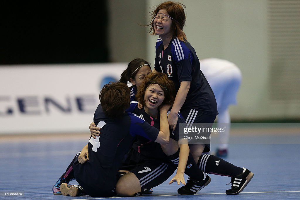 Chikage Kichibayashi #7 of Japan (C) is congratulated by team mates after scoring a goal against Iran during the Women's Futsal Gold Medal match at Songdo Global University Campus Gymnasium during day seven of the 4th Asian Indoor & Martial Arts Games on July 5, 2013 in Incheon, South Korea.
