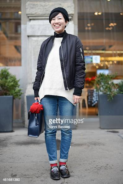 Chikako Ichinoi poses wearing a Topshop bomber Strasburgo sweater and Marni bag on January 17 2015 in Milan Italy