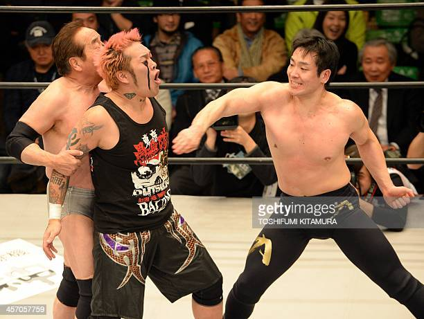 Chikara a grandson of late national professional wrestling hero Rikidozan hits a karate chop at Rongai Nosawa while his father Mitsuo Momota holds...