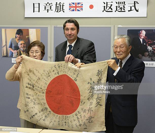 Chikuzen Japan A Rising Sun flag carried by former Japanese Imperial Army soldier Tokujiro Ogura during World War II is given back to his wife Fumi...
