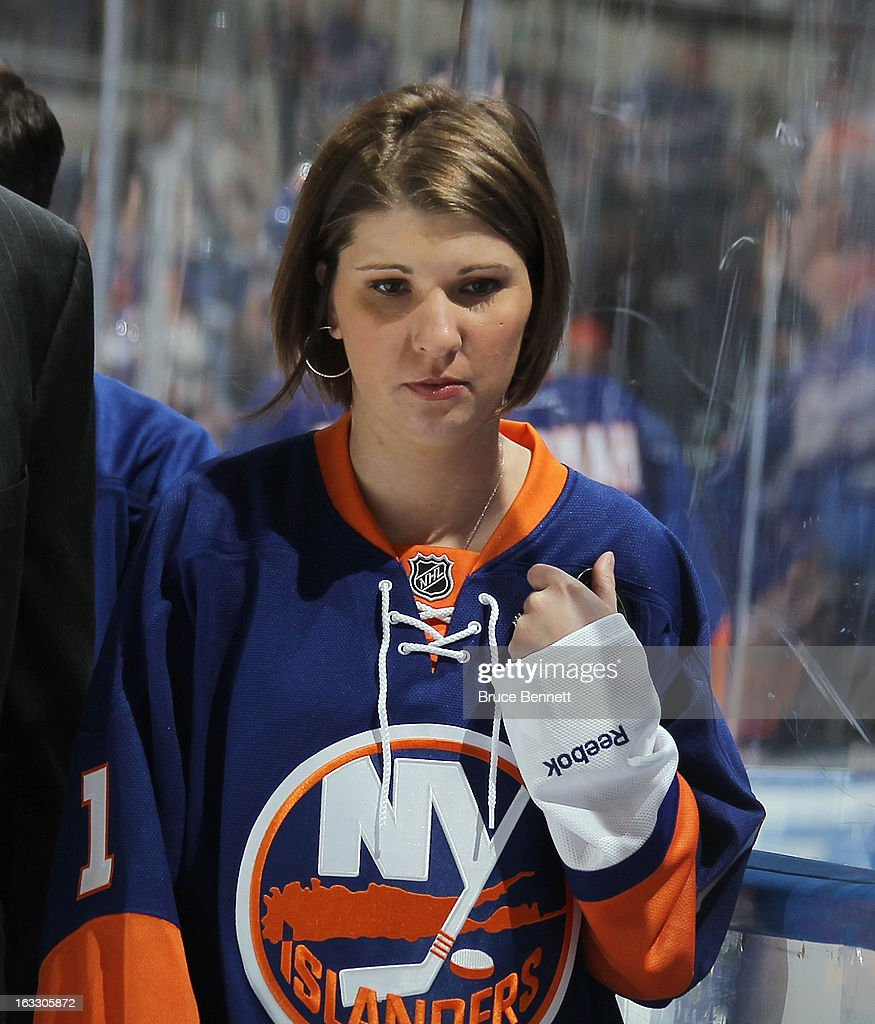 Child abuse victim Katie Beers leaves the ice after dropping the ceremonial puck prior to the game between the New York Islanders and the New York Rangers at the Nassau Veterans Memorial Coliseum on March 7, 2013 in Uniondale, New York.