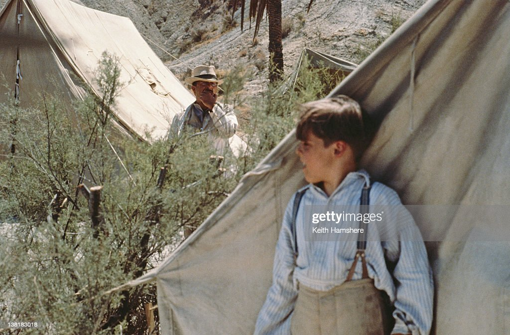 Child actor Corey Carrier as the titular character, keeping an eye on Tony Robinson as Pierre Duclos in the television series 'The Young Indiana Jones Chronicles', 1992. This scene appears in the first episode, 'Young Indiana Jones and the The Curse of the Jackal'.