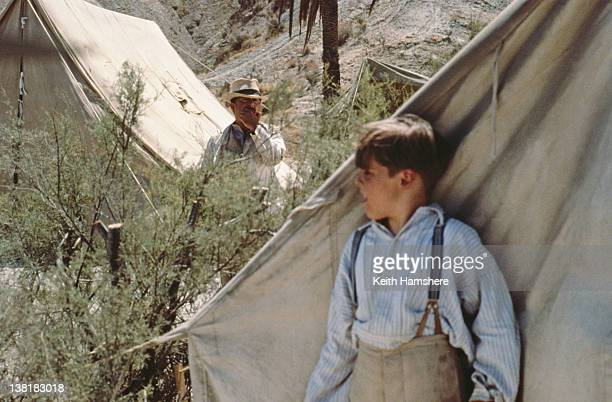 Child actor Corey Carrier as the titular character keeping an eye on Tony Robinson as Pierre Duclos in the television series 'The Young Indiana Jones...