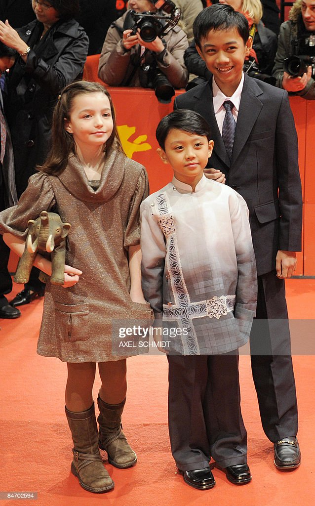 Child actors (L-R) Sophie Nyweide, Martin Delos Santos and Jan David Nicdao pose on the red carpet ahead of the premiere of the film 'Mammoth' by Swedish director Lukas Moodysson and presented in competition at the 59th Berlinale Film Festival in Berlin February 8, 2009. The Berlinale is taking place from February 5 to 15, 2009 with 18 productions vying for the coveted Golden Bear for best picture to be awarded February 14.