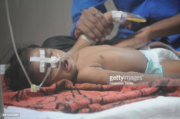 A child admitted in BRD Medical College where around 70 children have died for various reasons including lack of oxygen supply in last few days in...