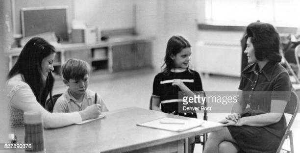Child Advocacy Team Discusses Problems With Students Members of team Penny Goss left and Dottie Montoya right converse with Bryan Van Deventer and...